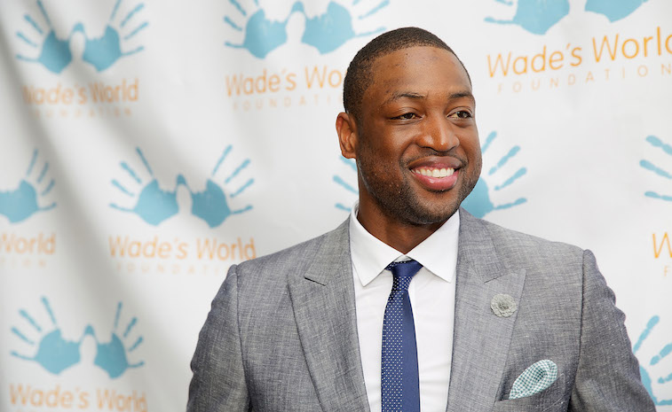 Dwyane Wade smiles during a charity event.