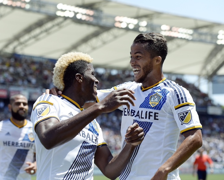 Giovani Dos Santos #10 of the Los Angeles Galaxy congratulates Gyasi Zardes #11 after he scored a goal