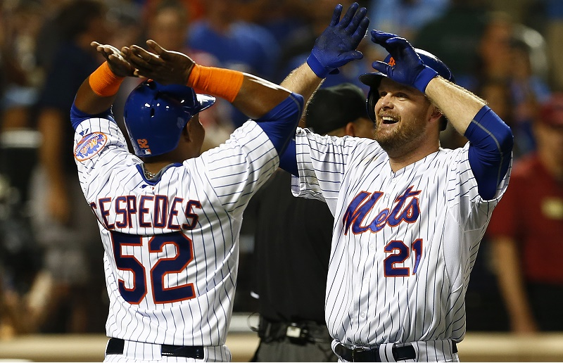 Lucas Duda #21 of the New York Mets is congratulated by Yoenis Cespedes #52 after both scored on Duda's two run home run