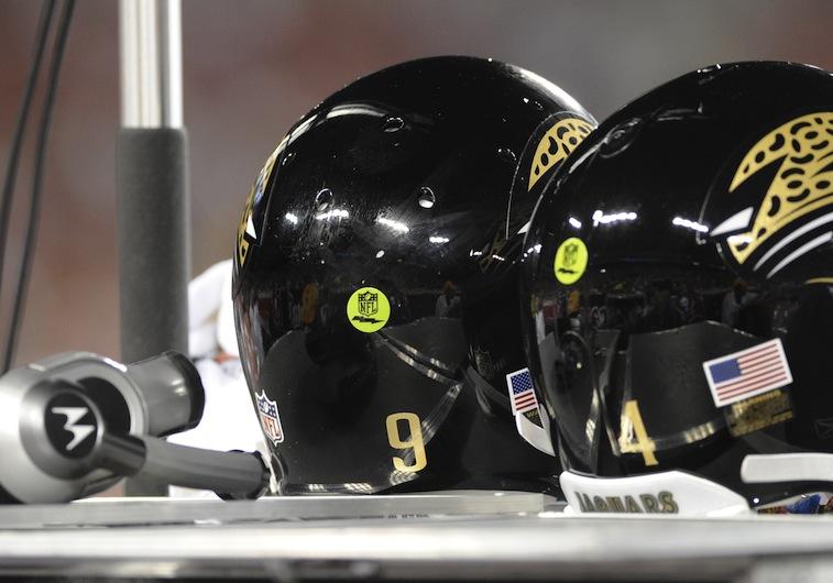 Helmets of the Jacksonville Jaguars quarterbacks display green 'radio' decals