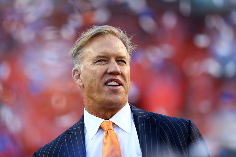 Denver Broncos General Manager John Elway watches a game from the sideline.