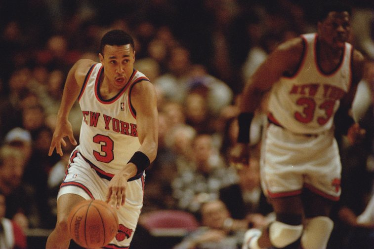 John Starks brings the ball up the court for the New York Knicks