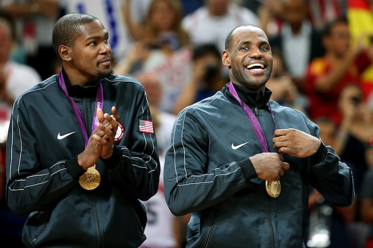 Kevin Durant and LeBron James celebrate Olympic gold
