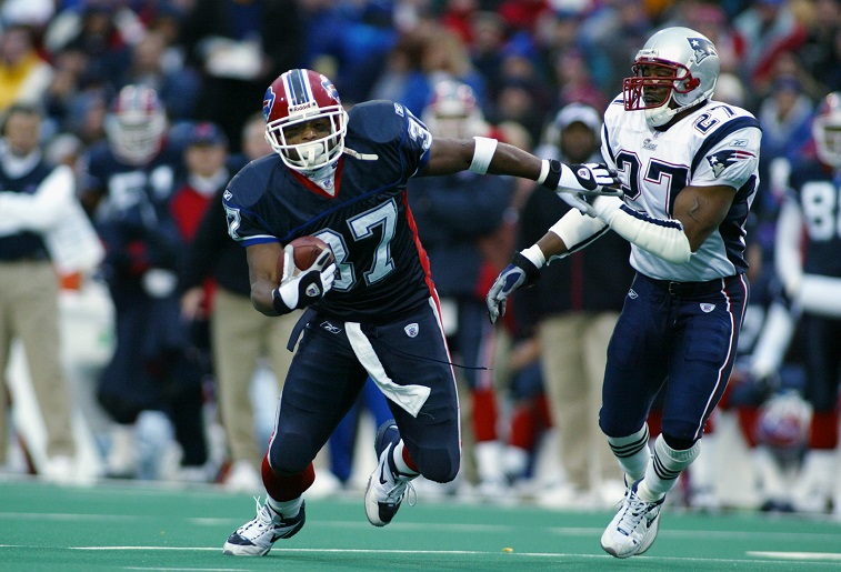ORCHARD PARK, NY - NOVEMBER 3: Fullback Larry Centers #37 of the Buffalo Bills avoids the tackle during the NFL game against the New England Patriots at Ralph Wilson Stadium on November 3, 2002 in Orchard Park, New York. The Patriots defeated the Bills 38-7.