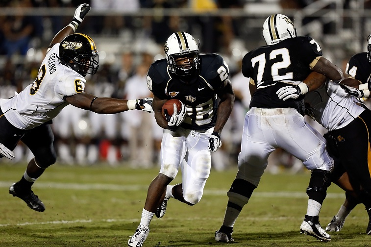ORLANDO, FL - OCTOBER 13: Running back Latavius Murray #28 of the Central Florida Knights scores a touchdown in the first overtime against the Southern Mississippi Golden Eagles during the game at Bright House Networks Stadium on October 13, 2012 in Orlando, Florida.