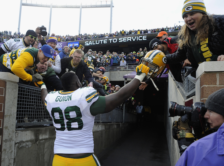 Letroy Guion high fives fans