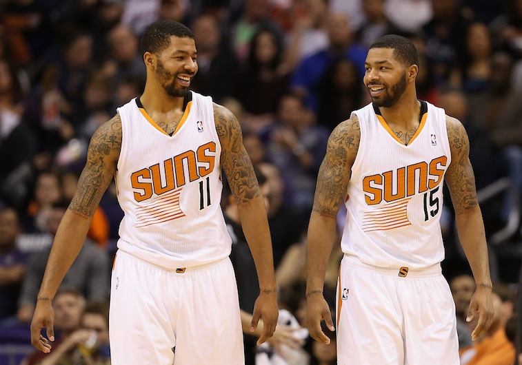 Markieff Morris #11 and Marcus Morris #15 of the Phoenix Suns react during the NBA game