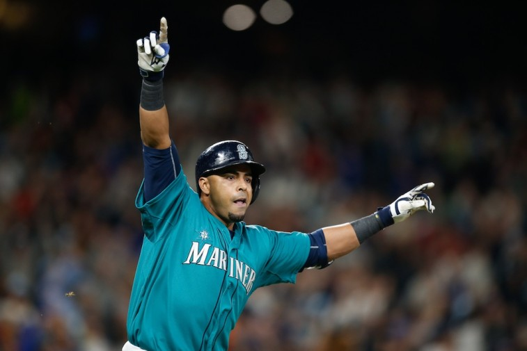 Nelson Cruz celebrates a walk-off single against the Red Sox