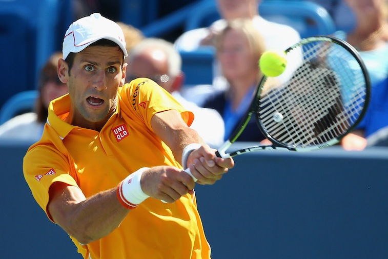 Novak Djokovic of Serbia returns a backhand