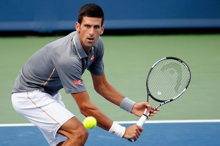 Novak Djokovic returns a shot during the Western & Southern Open