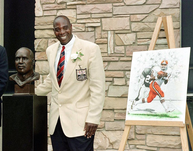 Ozzie Newsome poses next to his Hall of Fame bust | David Maxwell/Getty Images