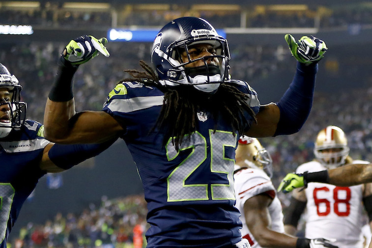 Jonathan Ferrey/Getty ImagesCornerback Richard Sherman #25 of the Seattle Seahawks celebrates after he tips the ball leading to an intereption by outside linebacker Malcolm Smith #53 to clinch the victory for the Seahawks against the San Francisco 49ers during the 2014 NFC Championship at CenturyLink Field on January 19, 2014 in Seattle, Washington.  (Photo by Jonathan Ferrey/Getty Images)