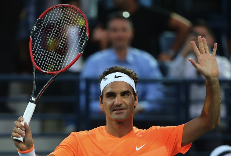 Roger Federer cheers his fans after winning his semi final match during the ATP Dubai Duty Free Tennis Championships