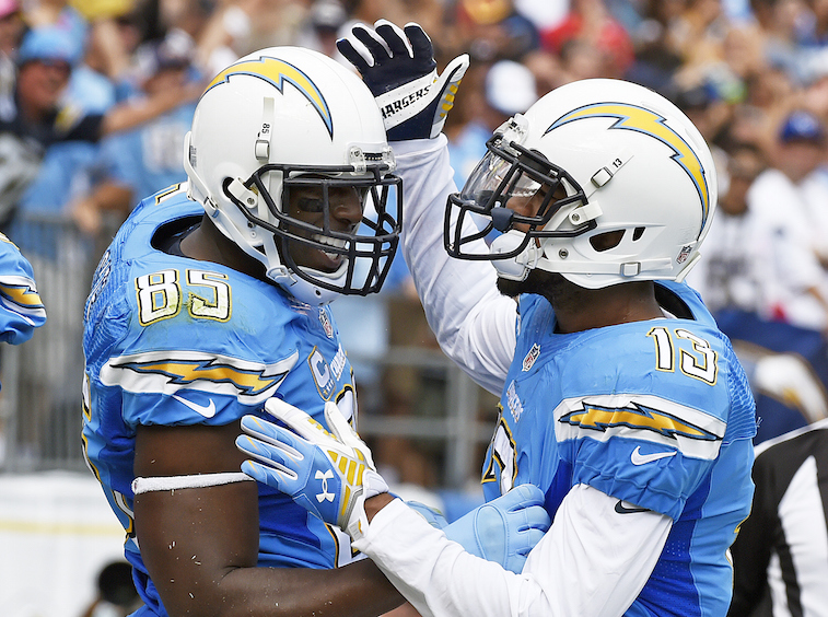 SAN DIEGO, CA - OCTOBER 19: Philip Rivers #17 of the San Diego Chargers celebrates his touchdown with Keenan Allen #13 against the Kansas City Chiefs during thean ir NFL game at Qualcomm Stadium on October 19, 2014, in San Diego, California. (Photo by Kevork Djansezian/Getty Images)