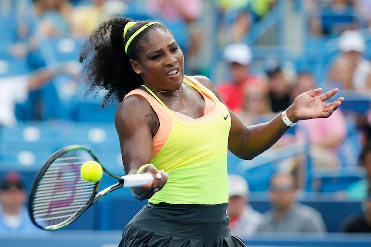 Serena Williams returns the ball in the women's finals of the Western & Southern Open