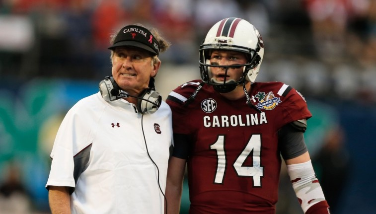 Steve Spurrier talks to quarterback Connor Shaw