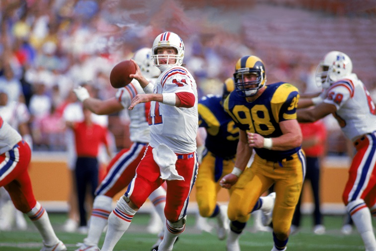 LOS ANGELES - 1986: Quarterback Tony Eason #11 of the New England Patriots rolls out under pressure during a 1986 NFL game against the Los Angeles Rams at LA Memorial Coliseum in Los Angeles, California. The Pats defeated the Rams 30-28.