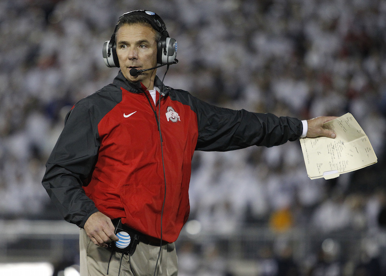 Urban Meyer, head coach of the Ohio State Buckeyes, coaches during a game.