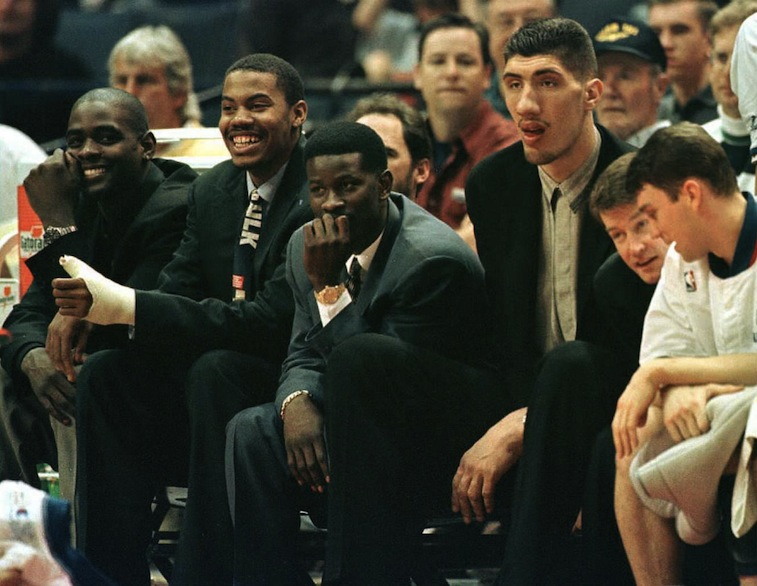 The Washington Bullets bench -- far right, Mark Price talks to brother Brent