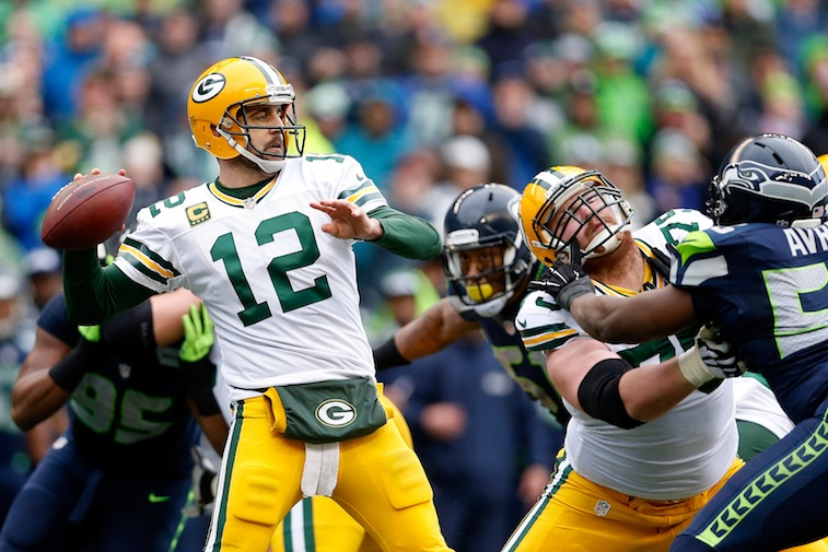 Aaron Rodgers goes back to throw against the Seattle Seahawks during the NFC Championship Game