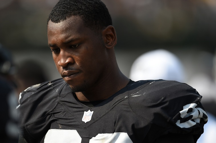 Aldon Smith looks on during game against the Bengals