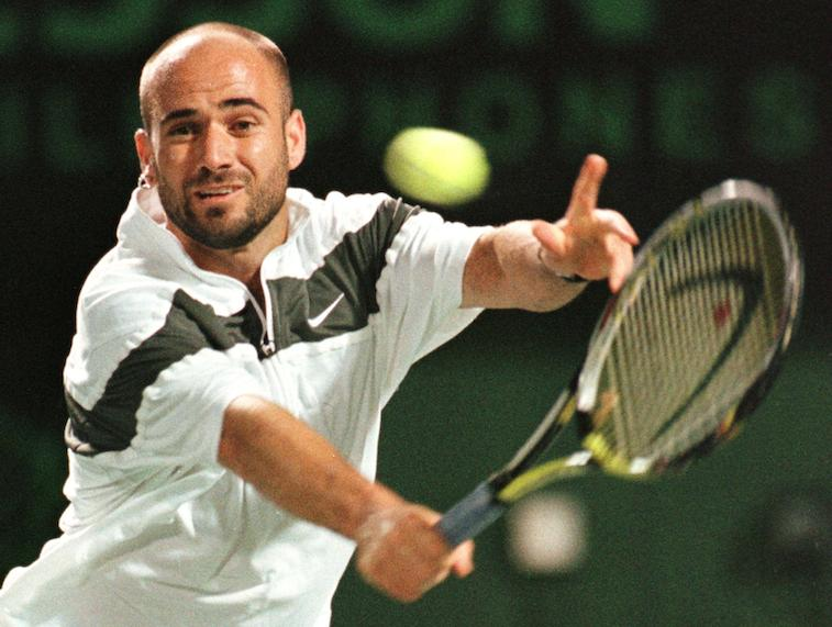Andre Agassi tries to return a shot