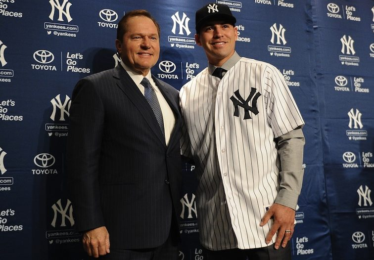 Jacob Ellsbury stands with the Yankees.