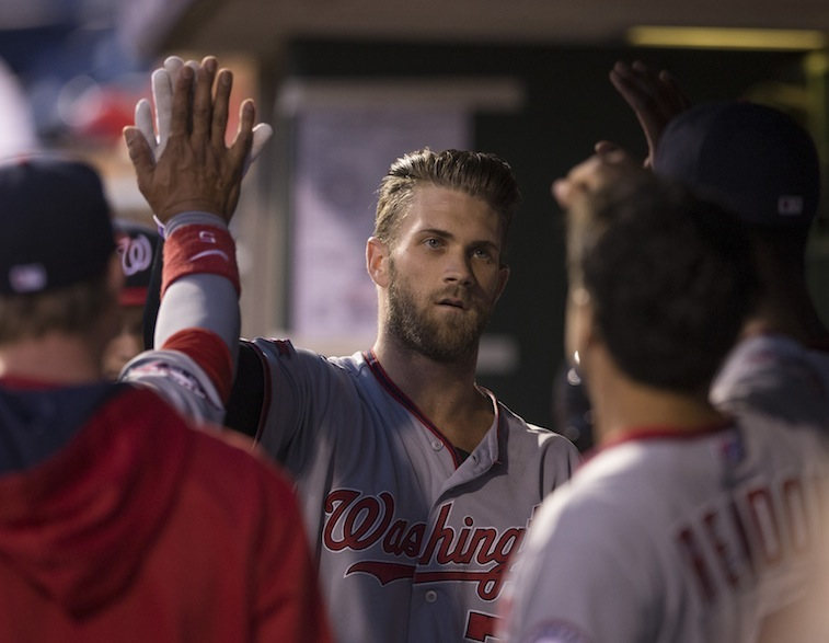 Bryce Harper celebrates in dugout with teammates