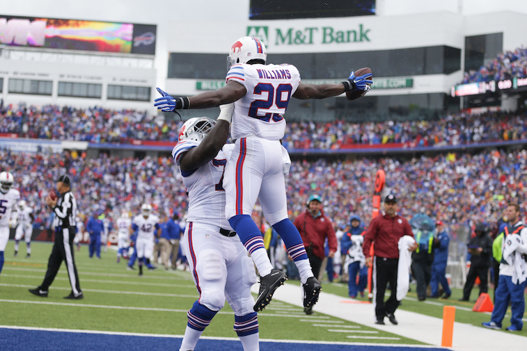 ORCHARD PARK, NY - SEPTEMBER 13: Karlos Williams #29 of the Buffalo Bills celebrates his touchdown against the Indianapolis Colts with John Miller #76 of the Buffalo Bills during the first half at Ralph Wilson Stadium on September 13, 2015 in Orchard Park, New York. (Photo by Brett Carlsen/Getty Images)