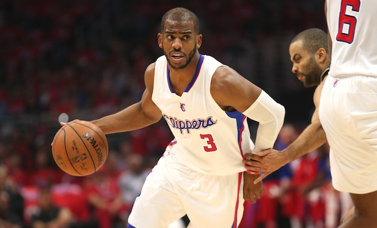Chris Paul dribbles against the Spurs