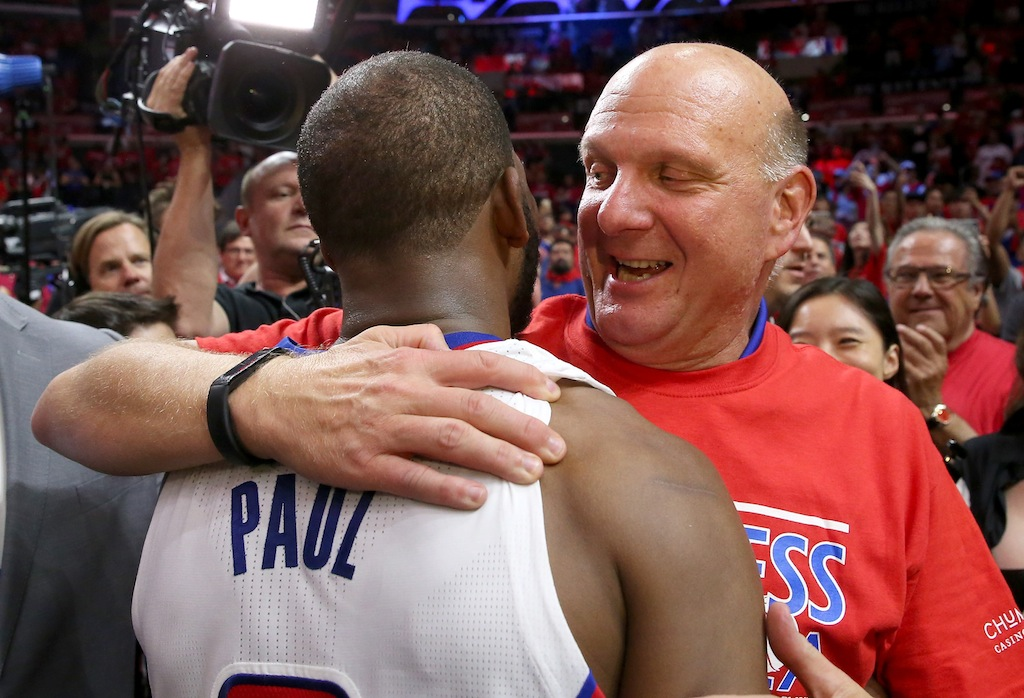 Chris Paul and Steve Ballmer embrace after the game