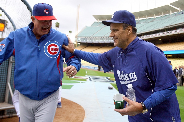 LOS ANGELES, CA - OCTOBER 04: Manager Lou Piniella of the Chicago Cubs talks with manager Joe Torre of the Los Angeles Dodgers before Game Three of the NLDS during the 2008 MLB playoffs on October 4, 2008 at Dodger Stadium in Los Angeles, California. The Dodgers defeated the Cubs 3-1 to advance to the NLCS.