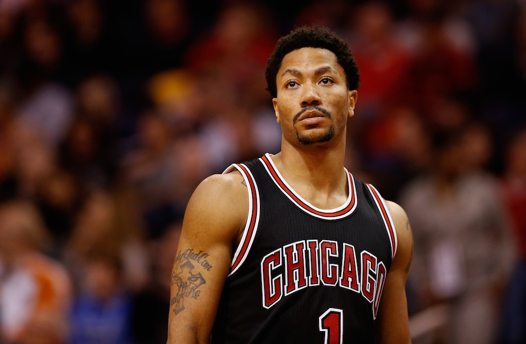 Derrick Rose looks on during a game against the Suns