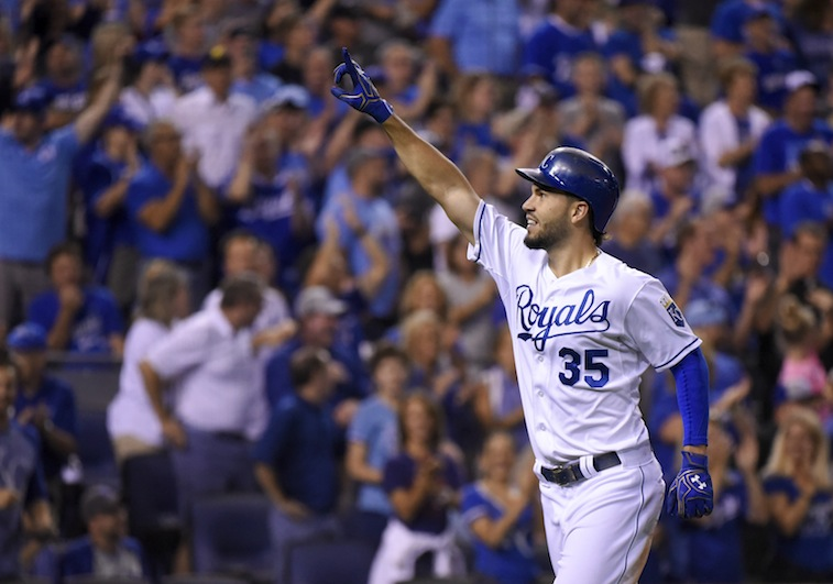 Eric Hosmer points to the crowd after his home run