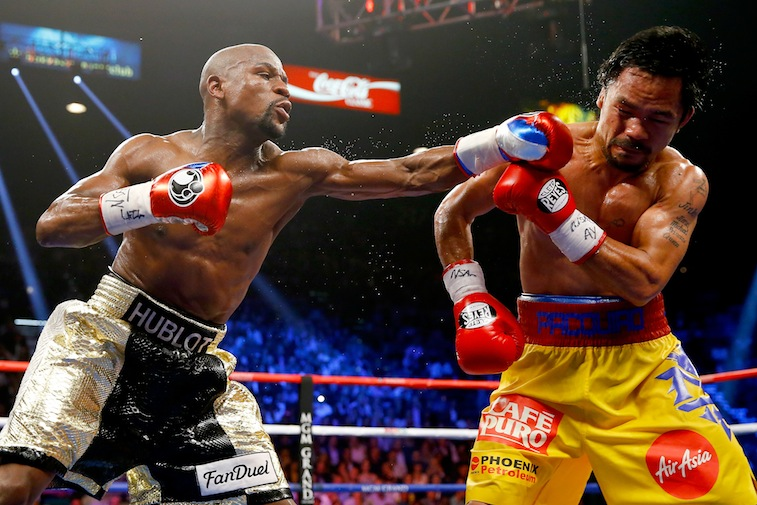 Floyd Mayweather Jr. and Manny Pacquiao box during their welterweight unification championship bout on May 2, 2015