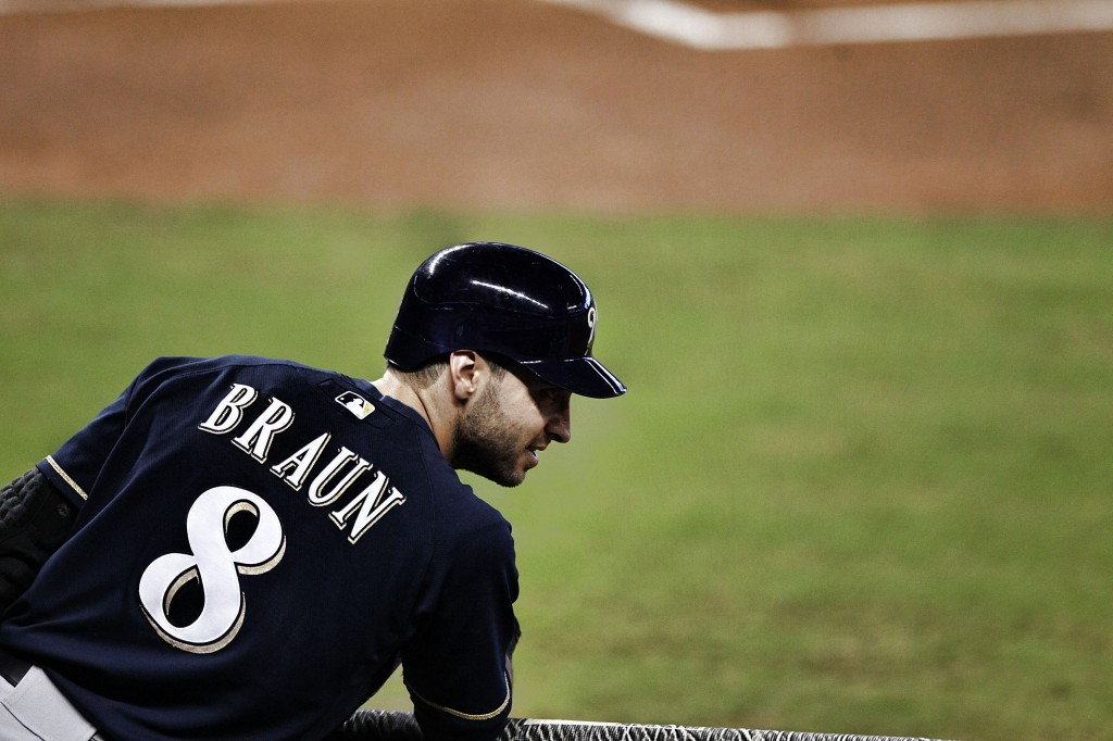 Ryan Braun watches from the dugout.