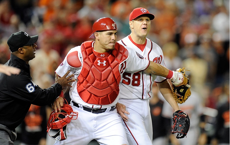 Relief pitcher Jonathan Papelbon is held back by his Washington Nationals teammate.