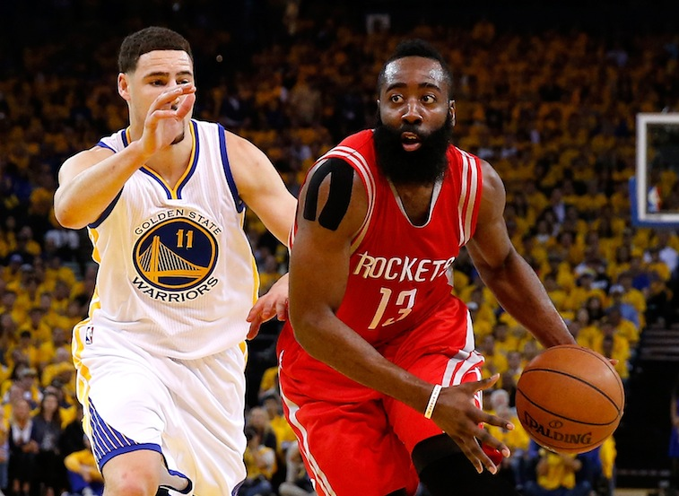 James Harden drives past Klay Thompson