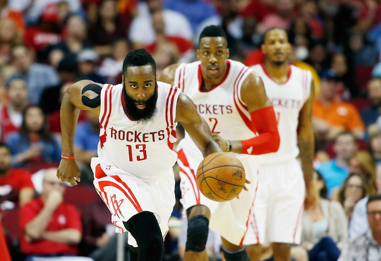 James Harden brings the ball up with Dwight Howard trailing