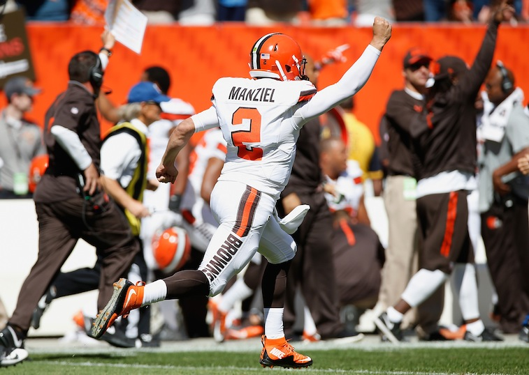 Johnny Manziel celebrates after throwing a touchdown