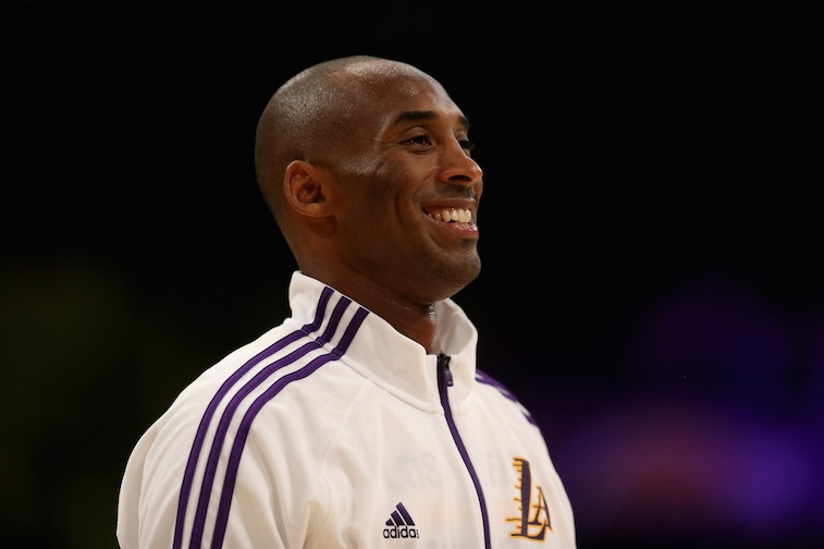 Kobe Bryant smiles before the start of a game