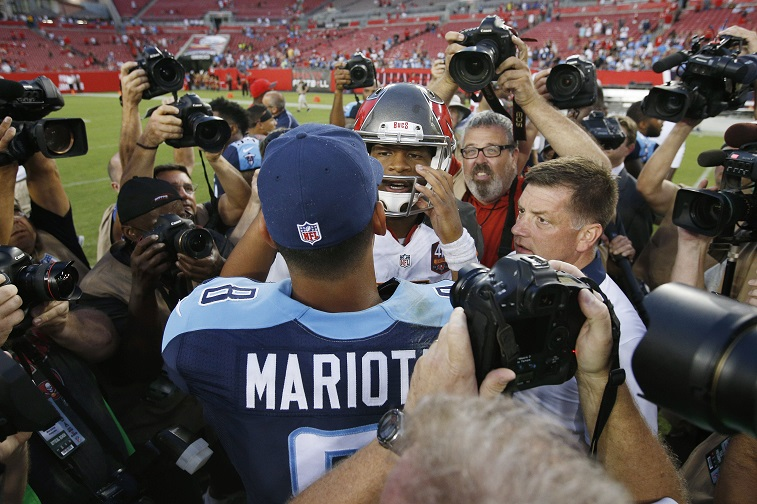 TAMPA, FL - SEPTEMBER 13: Jameis Winston #3 of the Tampa Bay Buccaneers and Marcus Mariota #8 of the Tennessee Titans meet after the game at Raymond James Stadium on September 13, 2015 in Tampa, Florida. The Titans defeated the Bucs 42-14.