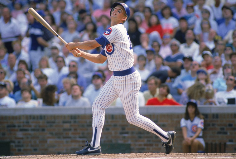 CHICAGO - SEPTEMBER: Mark Grace #17 of the Chicago Cubs pops the ball up during a September 1989 game at Wrigley Field in Chicago, Illinois.