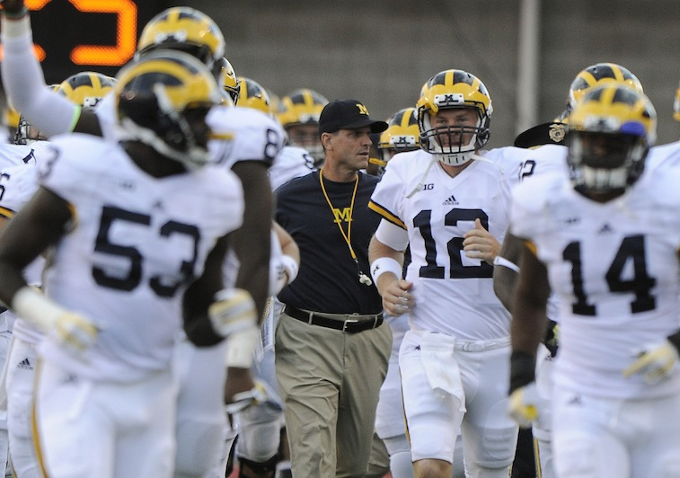 The Michigan Wolverines take the field for their game against Utah