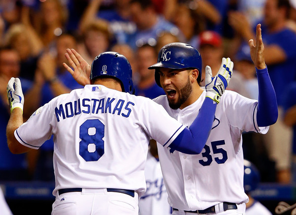 Mike Moustakas celebrates with a teammate.