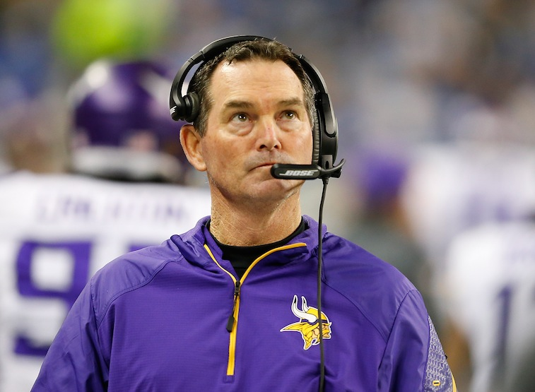 Mike Zimmer looks up at the clock during a game against the Lions