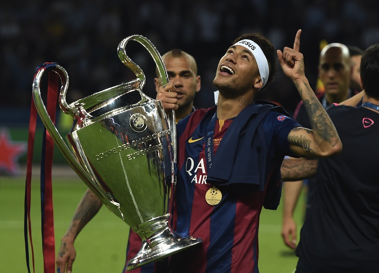 Neymar celebrates with Champions League trophy