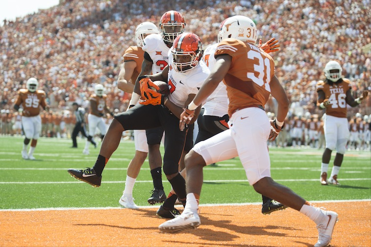 Brandon Sheperd #7 of the Oklahoma State Cowboys catches a 17 yard touchdown pass against the Texas Longhorns