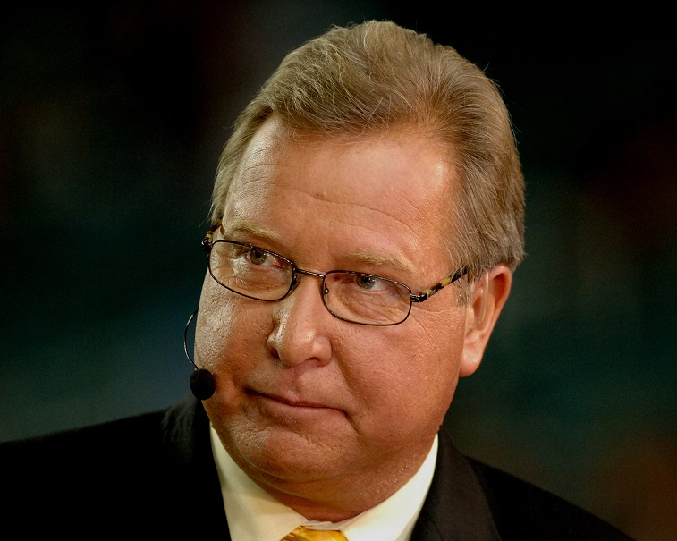 ESPN commentator Ron Jaworski  offers his thoughts during the pre-game  as the Philadelphia Eagles play  against the Atlanta Falcons  during a Monday Night Football game on ABC September 12, 2005 in Atlanta.