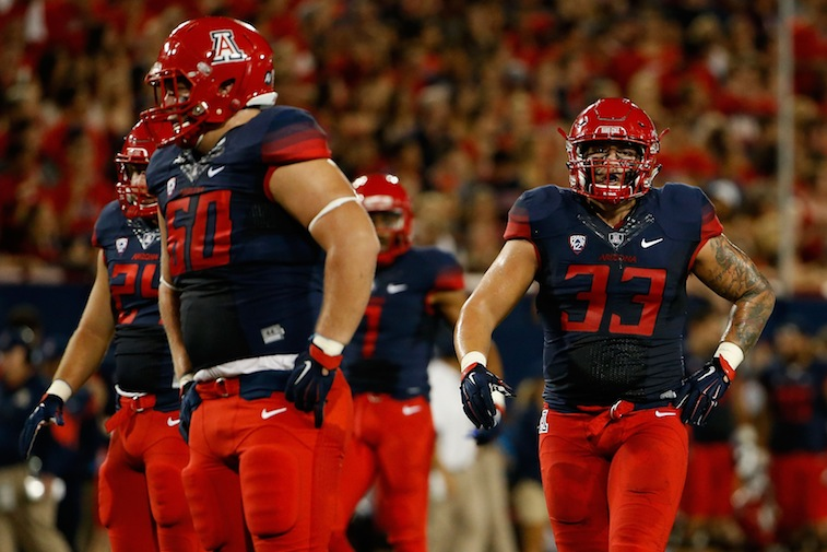 Scooby Wright (33) comes back onto the field for Arizona